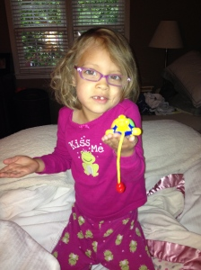 "New glasses that match these jammies, obv. She's showing you her new ""pet turtle."" Because a dog, a cat and two hermit crabs just weren't enough animal for one girl, apparently."
