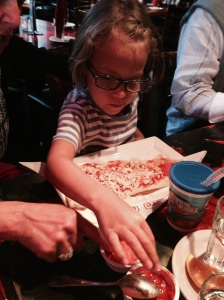 Making her own pizza (this place is amazingly kid-friendly, if you're ever in the area)